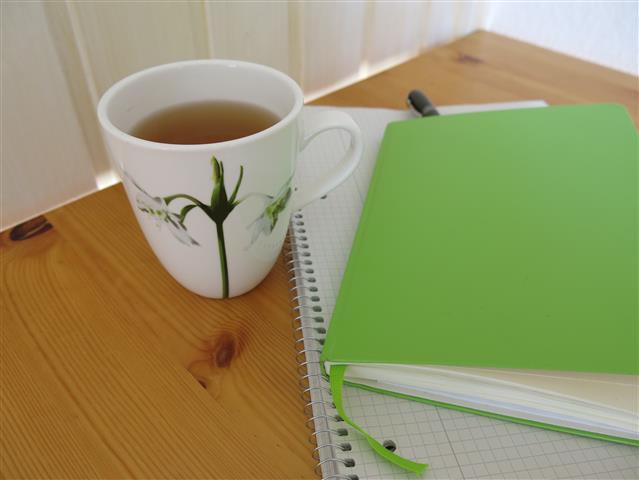 Tasse Tee Schreibtisch